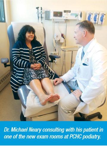 Dr. Michael Neary consulting with his patient in one of the new exam rooms at PCHC podiatry.
